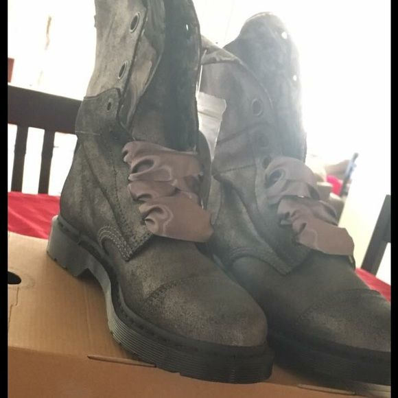Doc Martin Boots women's size 10 NWOT Doc Martin Boot never worn purchased for my daughter and she does not like them. Make offer been sitting in closet since Christmas. Darling ribbon laces with optional laces included Dr. Martens Shoes