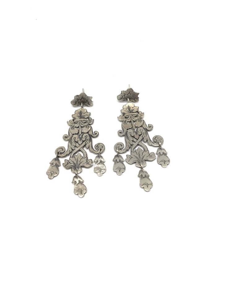 I Pizzi del lago.                                  Orecchini in argento fatti a mano in italia