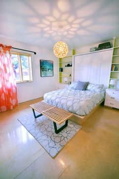 Great simple teenage room! Love the light fixture, something simple and young. Also the table at the end of the bed is great for quick set downs like clean folded laundry for quick put away, lunch plates if you like to eat in your room like I do, also you could make extra storage in you back board!