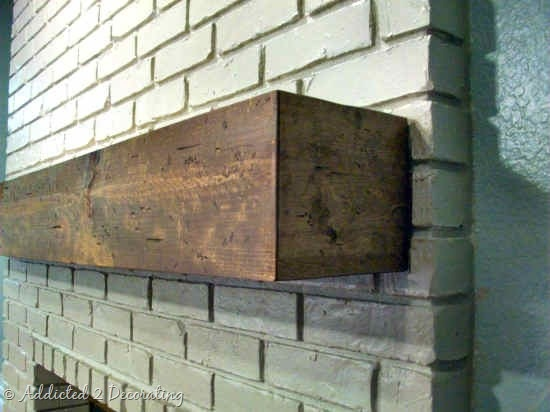 Mantel or wood shelf made to look like solid wood.