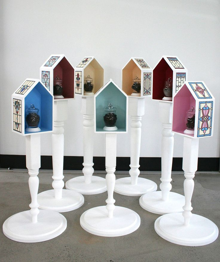 Sanctified By Fire 6 by Melanie Beresford Wood, Glass Sculpture - Sanctified by Fire Series - Limited Edition Signed Print of the Series Comes With the Sculpture - Wood, Enamel, Acrylic, Ash and Glass - Height 120cm x Diameter 40cm -   'Sanctified by Fire' is composed of seven house-like boxes elevated on table legs arranged in a circle. http://noellalopezgallery.com/Melanie-Beresford-Noella-Lopez-Gallery/melanie-beresford-sculpture-sanctified-fire-6?page=2