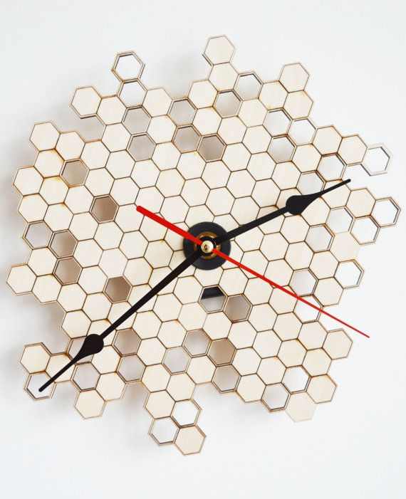 This modern wall clock with honeycomb pattern may just be the thing to make your house that little bit more stylish. It has been laser cut and engraved on untreated matte natural birch plywood for the quirky look.  Should you prefer a larger size please do not hesitate to enquire by sending us a convo.  ************************************************************  Features: Material: natural untreated birch plywood - non glossy  ************************************************************