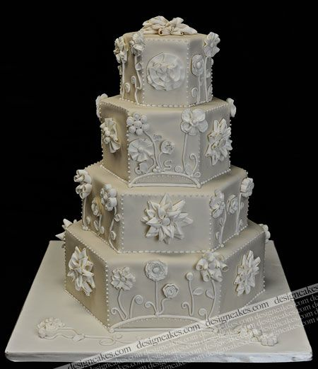 And yet another one that made my jaw drop. If this were my wedding cake, I would let people pose for pictures with it but no one would be allowed to eat it.