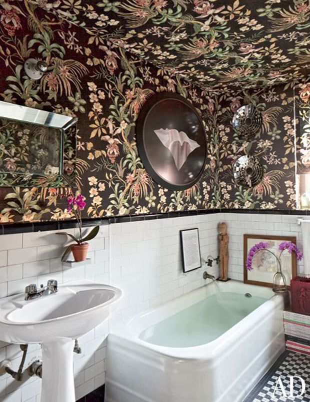 Splendor in the Bath. Carlos upholstered the walls and ceiling above the original 1930′s tilework in a dramatic tree-of-life motif with a black ground. Home of Style Editor Carlos Mota in New York City.