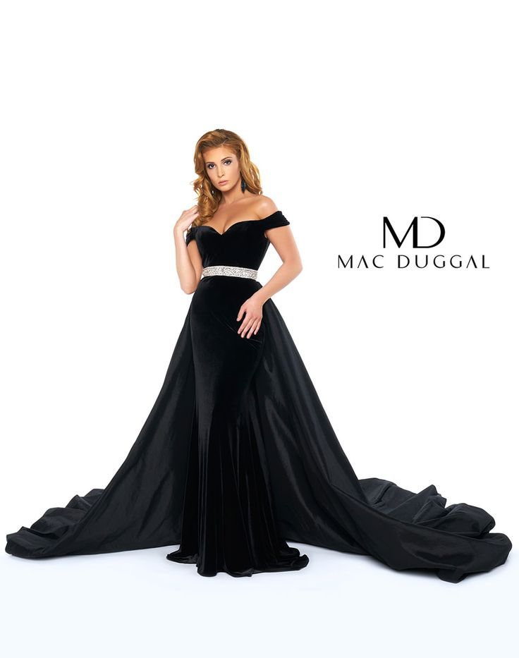 Black velvet pageant gown with off the shoulder neckline, beaded belt, and overskirt with train.