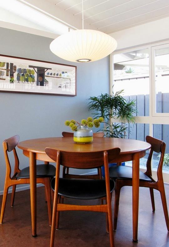 Between the vintage Nelson bubble lamp, wall art and '50s dining set, this dining room area photographed by Tara Bussema of Neat comes together in good midcentury form. Elegant mid-century modern s...