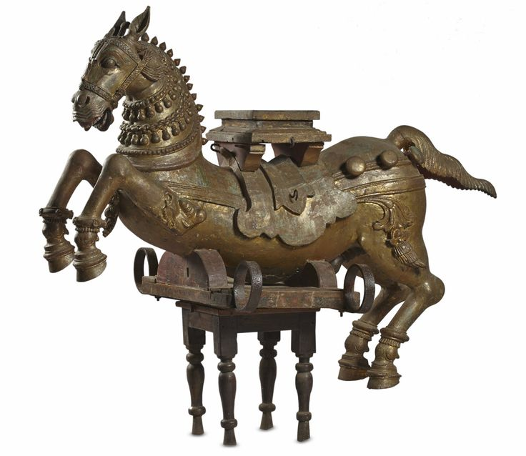 This carved wooden horse would have served as the #vahana or vehicle of a deity – probably Sri Devi or various avatars of Vishnu.The horse is depicted as though in motion. The body of the horse would have originally been delineated in gold, and further embellished with variously coloured painted motifs. The deity would have been placed  atop the small pedestal affixed to the top of the horse's saddle.#TamilNadu, #17thcentury