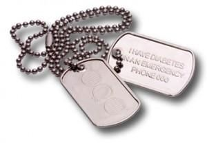 """Medi-Alert Dog Tags - $19.95  Medi-alert Dog Tags are similar to military dog tags. The tags are made from light-weight stainless steel, making them great for people of all ages, particularly those who are active. The first tag has the Diabete-ezy logo stamped into the stainless steel, while the other tag reads """"I HAVE DIABETES. IN AN EMERGENCY PHONE 000"""". Above this, there is enough space to have an engraver add your name or whether you have Type 1 or Type 2 diabetes, should you wish."""