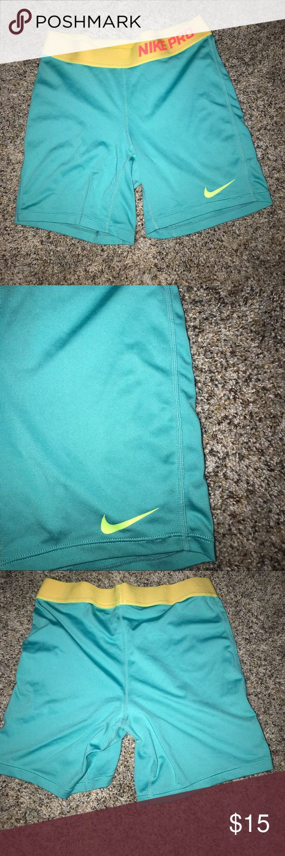 Nike Pro Spandex blue spandex with yellow and pink nike pro waist band and green…   – My Posh Picks