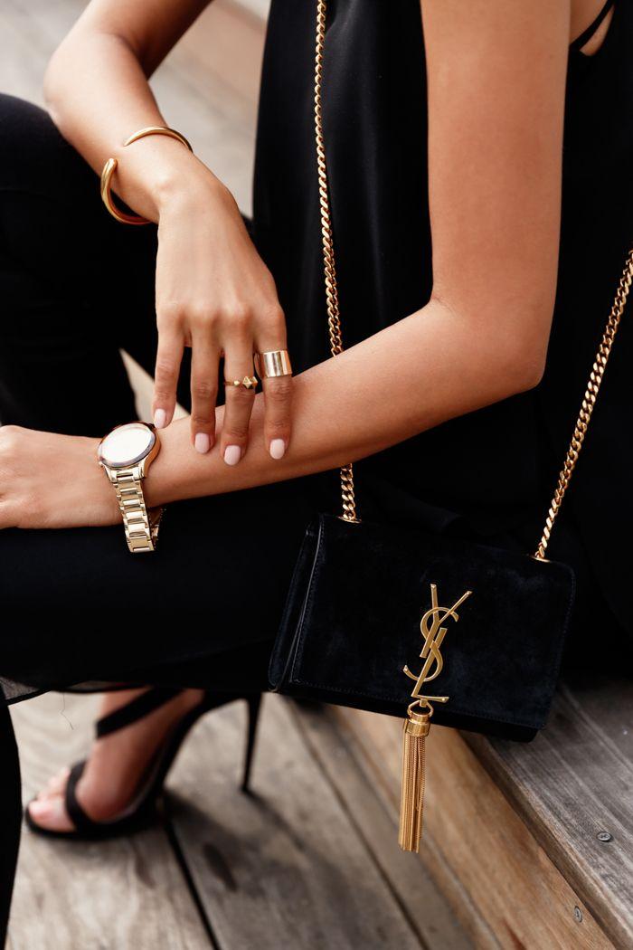 Need this crossbody! VivaLuxury - Fashion Blog by Annabelle Fleur: NOT SO BASIC BLACK - ASOS split side top & Ridley skinny ankle grazer jeans in clean black | PRADA retro sunglasses | SAINT LAURENT small Monogramme tassel chain bag | CARVELA Gosh black strap heeled sandals via ASOS | WANDERLUST & CO Trio Stack ring set July 2, 2015