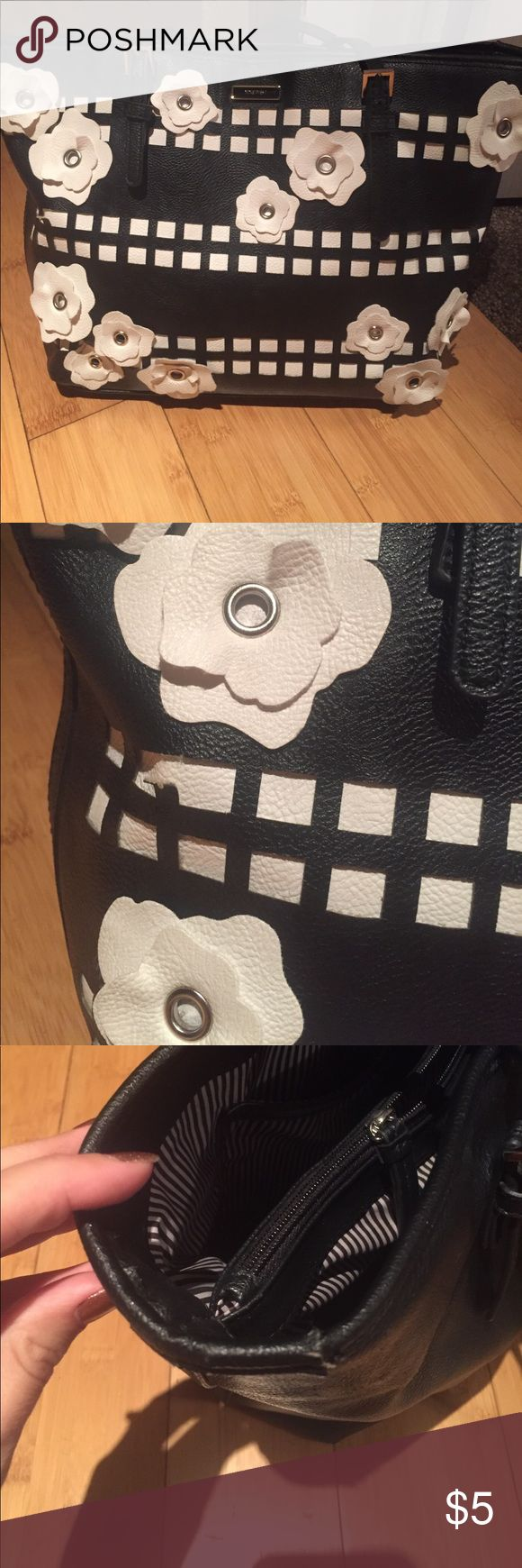 Black and white purse Black and white flowered purse .  Used with flaws . The handle is tearing .large purse nine west  Bags Shoulder Bags