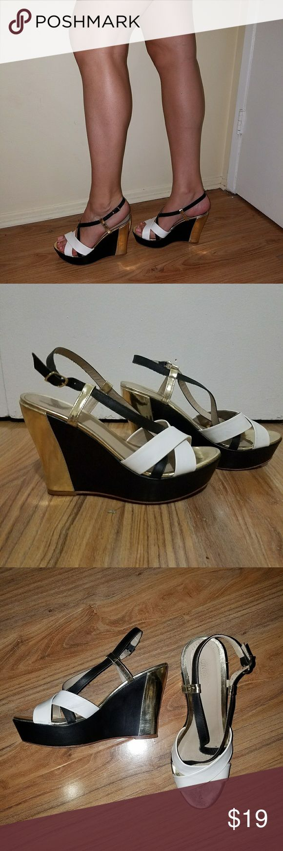 """Gold white and black strappy wedges Sleek black and gold base with white criss cross steps Surprisingly comfy and very easy to walk in 4.75 inch heel with a 1.5"""" platform  Worn 1x while filming a tv show indoors Shoes Wedges"""
