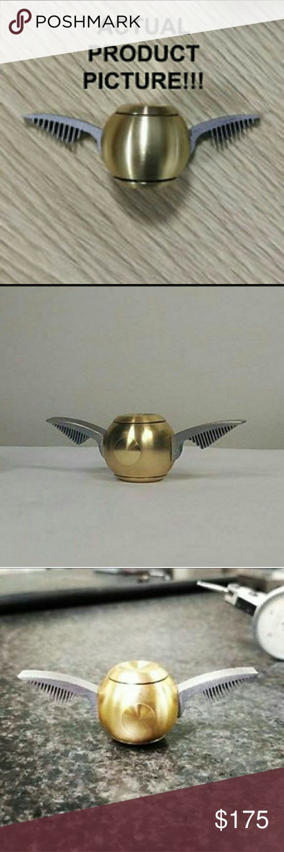 Golden Snitch Harry Potter Fidget Spinner RARE EXTREMELY HARD TO FIND Golden Snitch Harry Potter Edition fidget spinner; finally brought too life.   Anyone who's a fan and watched the classic Harry Potter films all remember the golden snitch and how bad you wish you could've catched it yourself.  This is the chance of a lifetime too own a piece of that memory and feel it in real life.   Very high quality gold plating, fidget spinner is high quality as well.Brand new in packaging. Free…