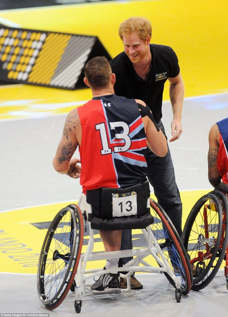 Prince Harry greets team players during the Wheelchair Basketball Finals medals ceremony at te Invictus Games Orlando