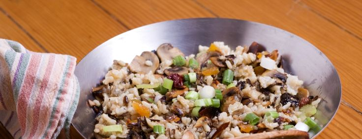 Wild rice and brown rice are good companions in this tasty pilaf. Crunchy pumpkin seeds and sweet dried currants round out the dish.