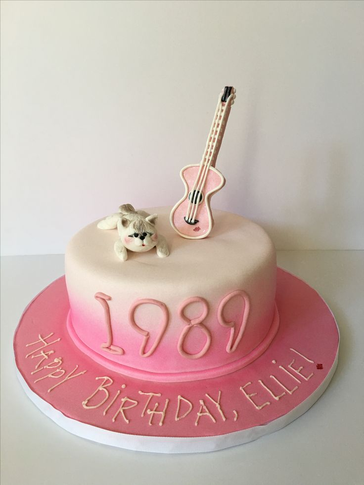 Taylor Swift 1989 album birthday cake, complete with fondant guitar and signature red lipstick and fondant kitty cat. Pink airbrush and fondant detail. The idea for this design came from another baker on Pinterest - can't take credit for this cute design!