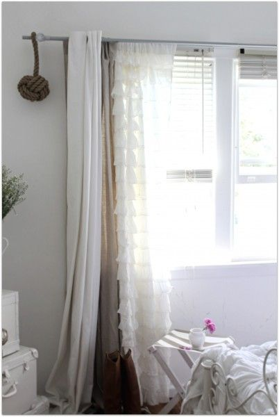 Layered curtains on A Beach Cottage.  This has been the plan for my living room!! Who's reading my mind?