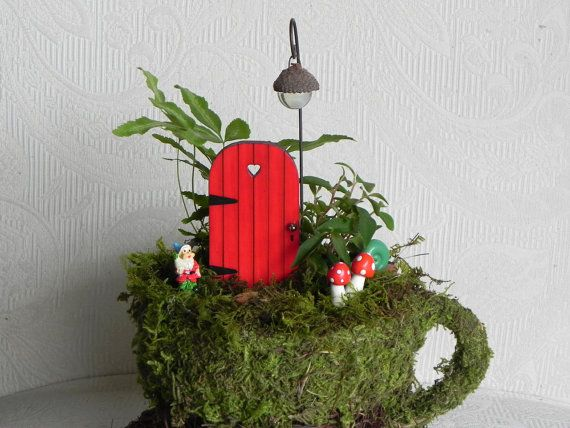 A delightful tiny little hand crafted fairy door to add to you miniature garden, fairy garden or use as a tooth fairy door.    Shown here in a