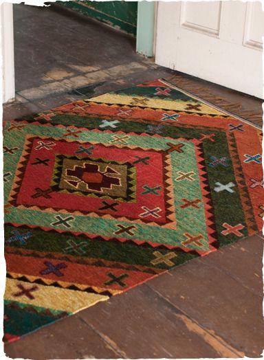 Kaffe Fassett's kilim rug in rich hues and bold geometrics. Stunningly handwoven in vegetal-hued wool. Cotton warp.