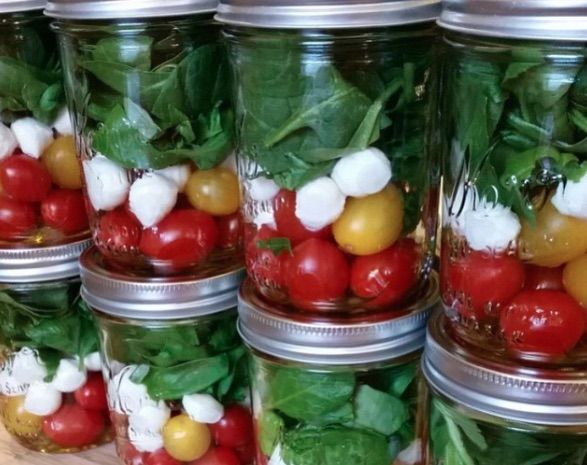 Caprese Mason Jar Salad. balsamic vinaigrette on bottom then tomatoes, boconccini, then basil or spinach