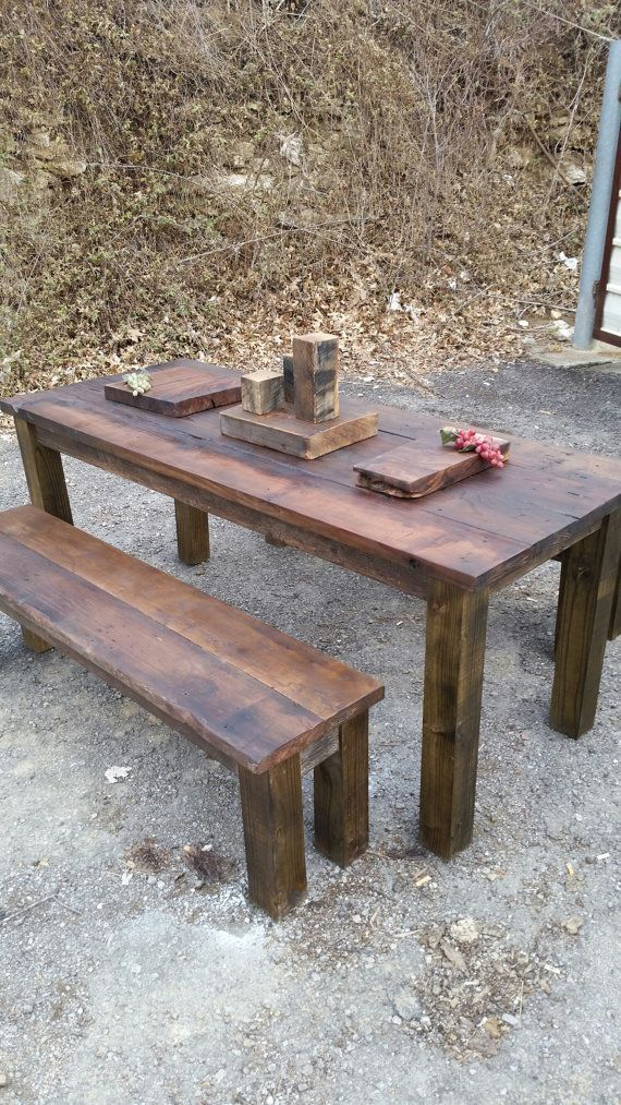This is a gorgeous-rustic pub style dining set that is made from 115 year old hard knotty pine wood. The table is made with single vertical reclaimed