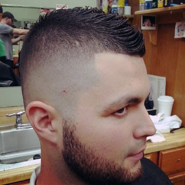 Faux hawk slash bald fade