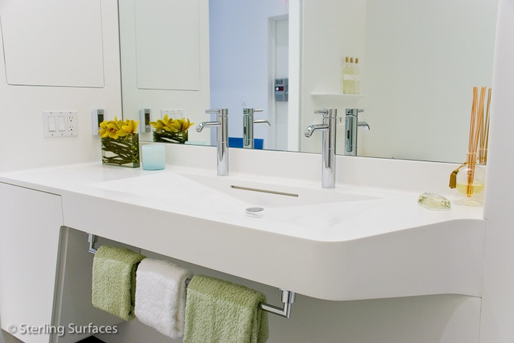 Corian top with a custom Corian bowl.  Fabricated by Sterling Surfaces  www.sterlingsurfaces.com