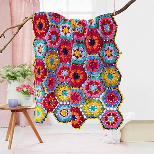 If you can granny square then this beauty is your next challenge. The pattern, rated as intermediate crochet, uses double treble to make the hexagons grow quickly. The instructional leaflet includes written instructions and a full stitch diagram, so whichever your preferred style of pattern reading you'll be ready to hook!