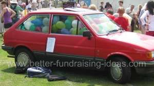 Guess how many balloons in the car? Even better if its the headmaster's car, the vicar's car, the team mini-bus etc