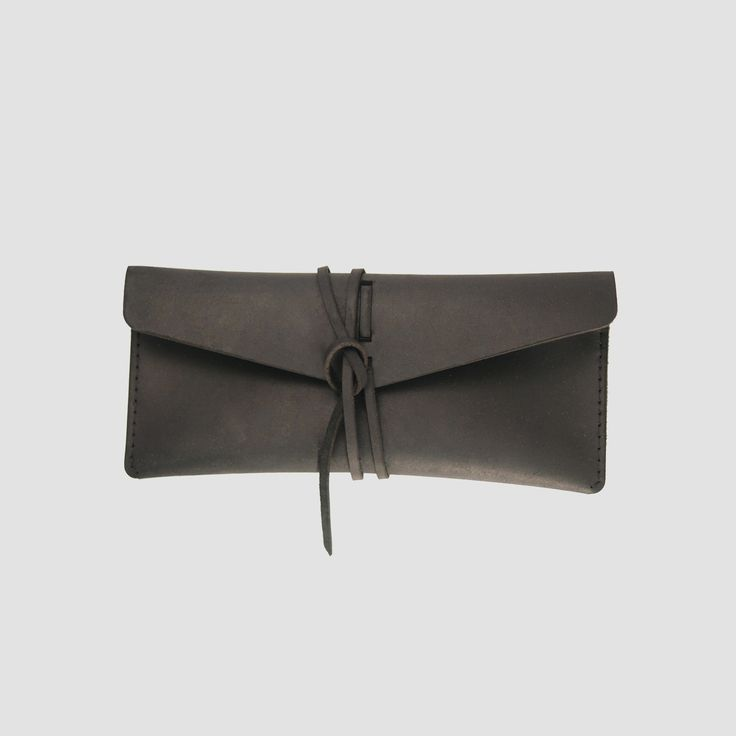 """This item is secured with a leather tie and can be used for sunglasses, stationery, or whatever you desire.Handcrafted in Toronto, Canada.4 Ounce Black Stone Oiled Leather Exterior Dimensions: 8"""" x 4"""""""