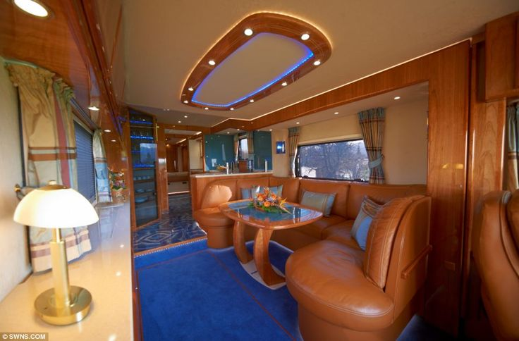 Guests: The lounge area of this bus boasts leather seats and expensive wood finishes. The perfect place to relax with a glass of champagne