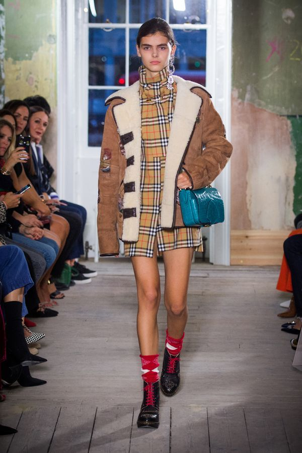 A Vintage check riding shirt worn under a caramel-coloured shearling jacket and The Square Satchel in dark teal.