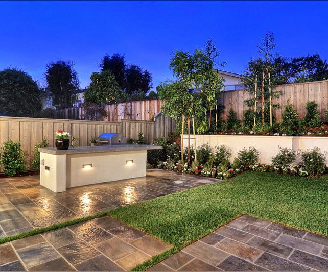 Outdoor Kitchen Ideas.  A custom built in kitchen area, including a barbeque and bar, make entertaining a cinch.  #OutdoorKitchen #BBQ