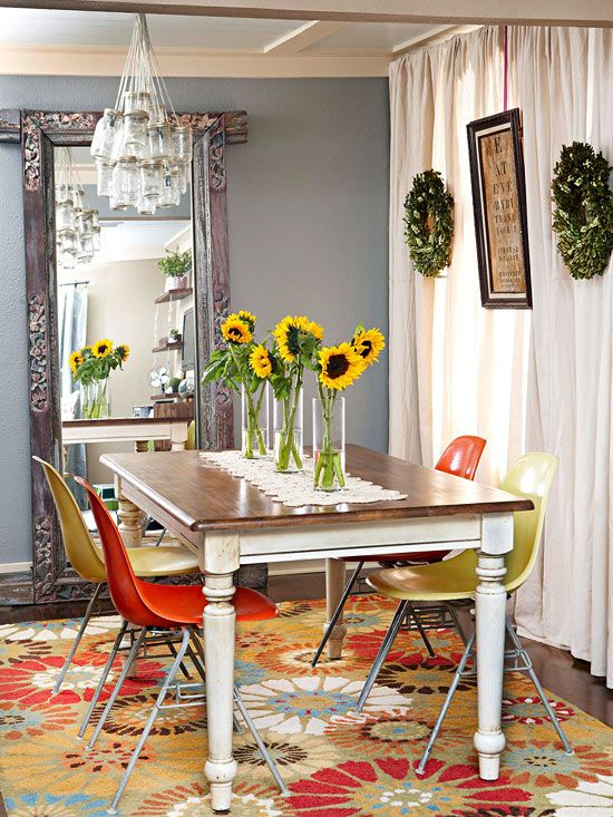 Such a young and hip dining room! The mirror in this dining room -- a mirrored closet door placed in a doorframe scored at a yard sale -- isn't the only thing that reflects the homeowners' DIY style. The curtains are fashioned from drop cloths hot-glued together.