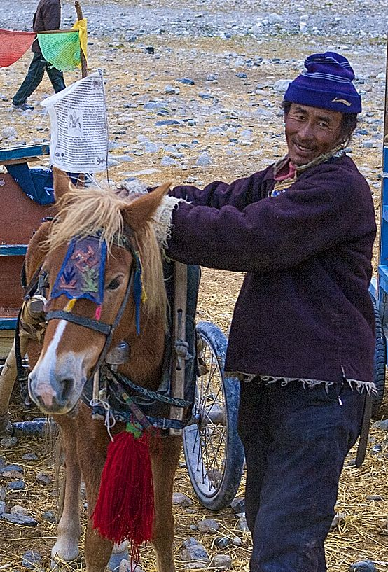 A pony cart driver at Mt Everest in Tibet. After you arrive at the collection of test guest houses where tourists stay, there is still a three kilometer trek to the actual base camp. You can walk or take a horse cart to the camp.