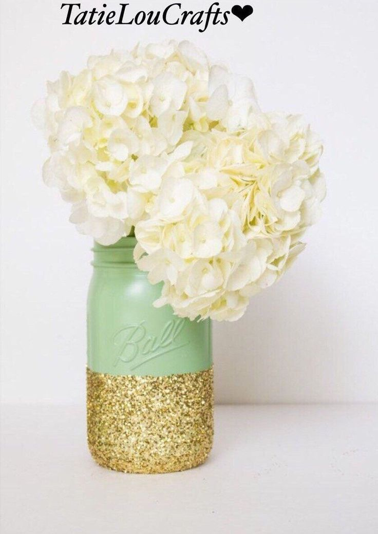 SET OF 4 Mint Green And Gold Quart Size Mason Jars// Wedding Centerpiece// Wedding Decor// Baby Shower// Sweet Sixteen Decor// Home Decor. by TatieLouCrafts on Etsy https://www.etsy.com/listing/265565617/set-of-4-mint-green-and-gold-quart-size