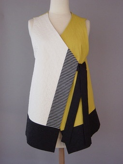 This is a happy colored vest. Japanese cotton quilted to silk. Right front panel has a chevron quilted pattern, hand-woven stripe accent panel. - Juanita Girardin