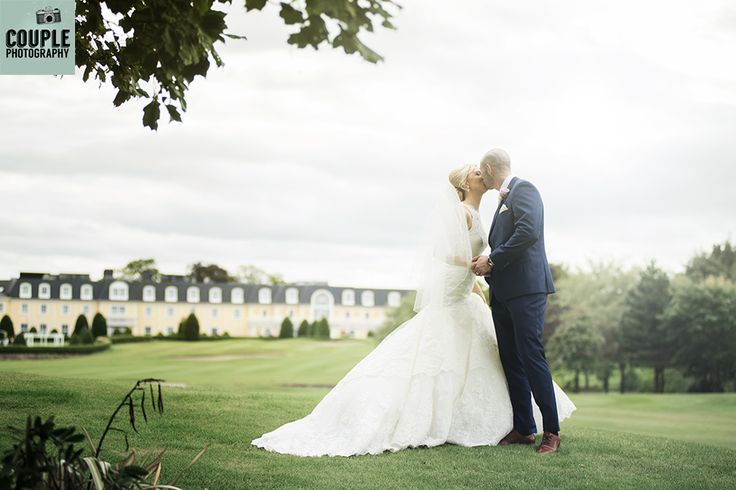 A romantic shot with the hotel in the background. Wedding Photography at Mount Wolseley by Couple Photography.