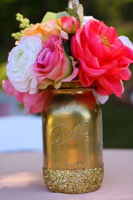 Gold mason jars with flowers at a Glamping Party #glamping #partyflowers