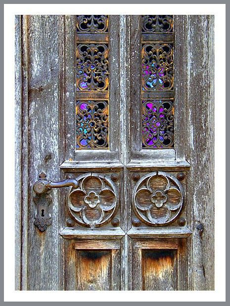 Aurora Borealis Ornate Windows on Weathered Door