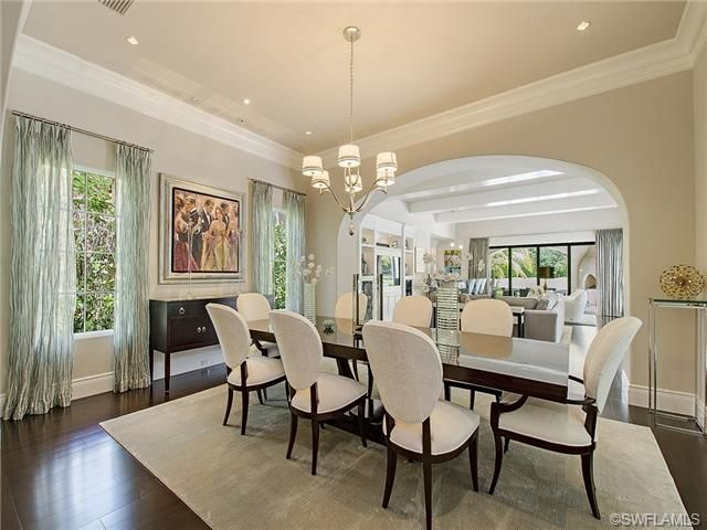 "Casual ""formal"" dining - table for 8 - white chairs - drapes.  Estuary at Grey Oaks in Naples, FL"
