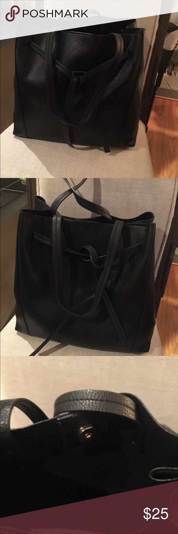 """Banana Republic black tote Banana Tepublic black tote.  Stop can tie close slightly to create another look.  No pockets inside. Fairly simple and classy tote.  12"""" wide x  7"""" x 12"""" deep.  Also has outside cellphone pocket on back of purse.  This is faux leather. Banana Republic Bags Totes"""