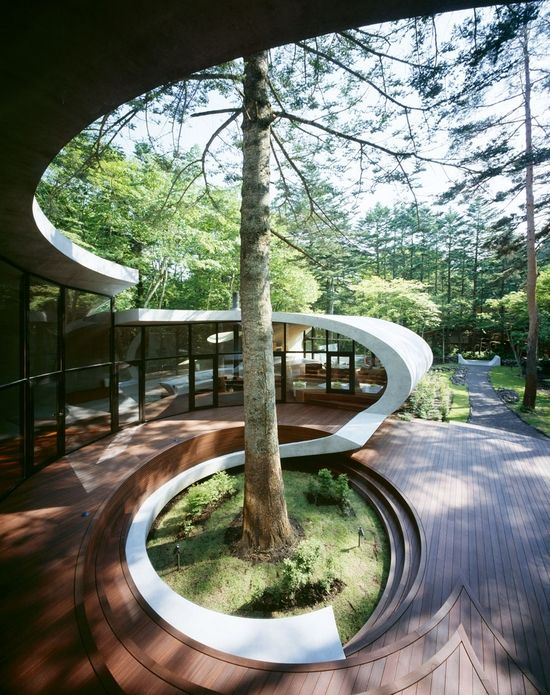The Japanese Architects ARTechnic have recently built this ultra sleek and quite modern villa in Karuizawa, Japan. I think the design is really beautiful, the curves and shapes have such a unique and organic feel and I like that they designed the home around a single tree.