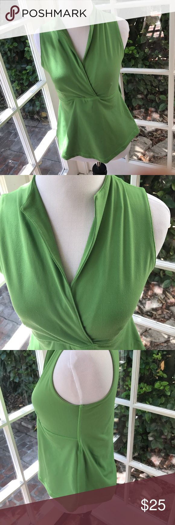 Lululemon size 12 green tank This is an awesome tank top!  Beautiful green color. Built in bra with deep v neck and collar. Small stain on inside of bra and Some spots on front too as pictured. 86% nylon and 14% Lycra. Size 12 but fits snug.  21 inches long. Pit to pit 26 inches. Vneck 10 inches. Waist 14 inches. lululemon athletica Tops Tank Tops