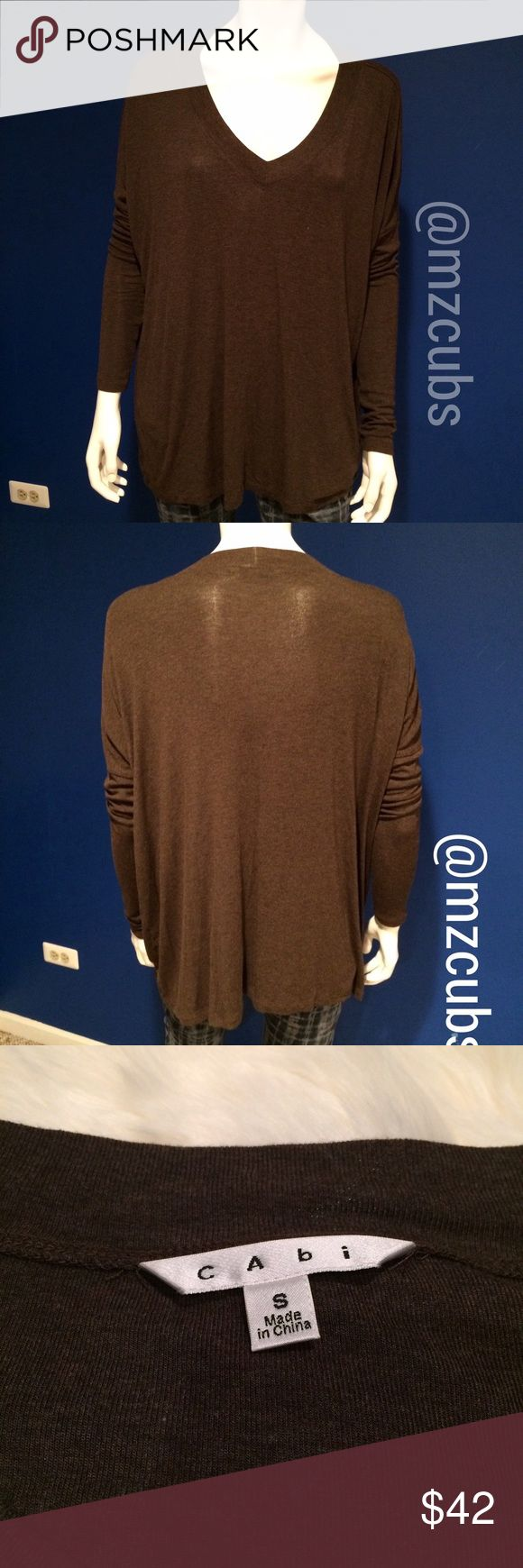 Brown Cabi Slouch Tee EUC. 🚫NO offers. Dark chocolate in color. 1st & 3rd pictures closets to actual color. Cabi slouch tee #569.  Super soft, dolman sleeve,  boxy oversized style and v-neck for a slouchy fit. 96% rayon, 4% spandex. 💰I offer 10% off 3 or more items. ⬇1-24 CAbi Tops Tees - Long Sleeve
