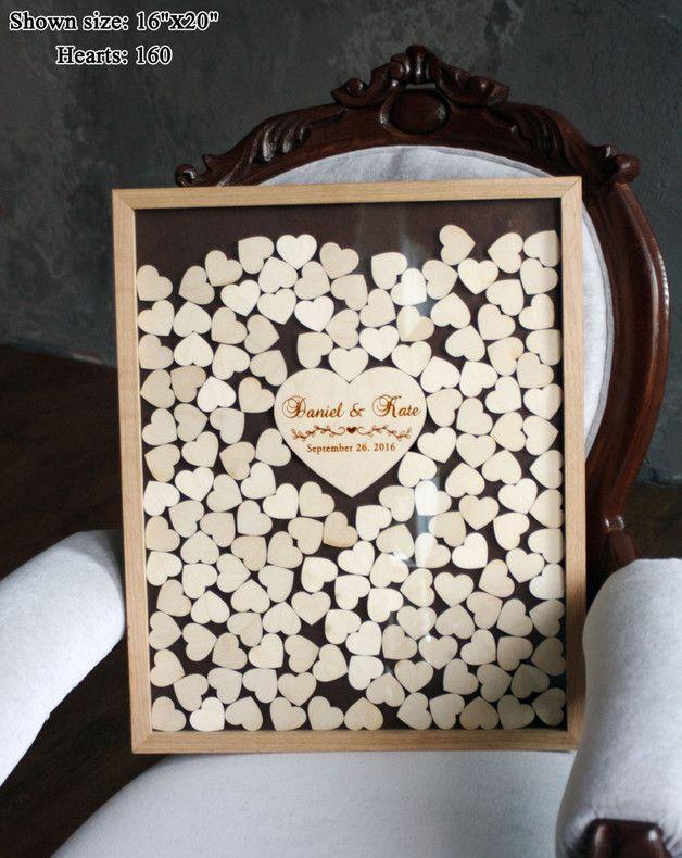 Besonderes Gästebuch mit Herzen aus Holz, Erinnerungen der Hochzeit / perfect wedding memories: guest book with wooden hearts in a frame made by Wooden Engraved Shop via DaWanda.com