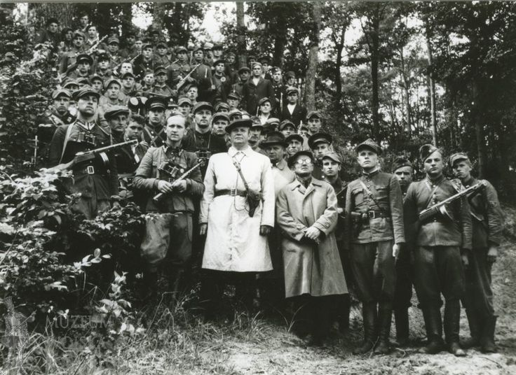 General Michał Rola-Żymierski (center, in white trench coat) with the partisans of the Polish People's Army (Armia Ludowa), 1944.