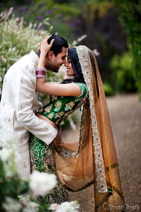 http://weddingstoryz.blogspot.in/ Indian Weddings Desi Weddings Bride makeup jewelry lehenga green ocher Beautiful picture!