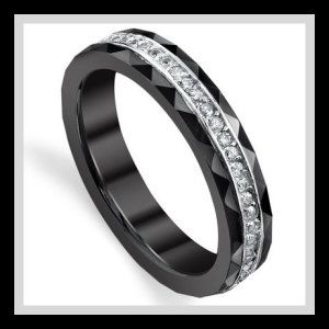 Ceramic and Sterling Silver Women's Eternity Wedding Band Ring with CZ These Womans Ceramic Wedding Rings are 4mm in width and have faceted edges. It has like all rings a 100% Money Back Guarantee and a FREE ring Box. http://theceramicchefknives.com/womans-ceramic-wedding-rings/ Ceramic and Sterling Silver Women's Eternity