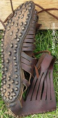 Caligae - Boots (Sandals)   Roman boots were made of several thicknesses of leather, studded with conical hobnails for marching over rough ground and using on the enemy when he had fallen.              The metal studs on the soles helped prevent the leather wearing down quickly.